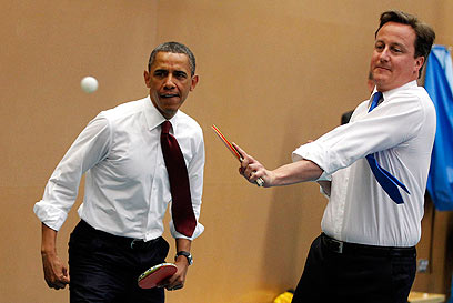 Thus will be done… – Cameron visiting Obama.