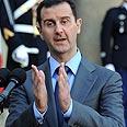 """""""מונע חופש ביטוי מבני עמו"""". בשאר אסד צילום: AFP"""
