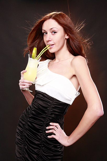 Girl alcohol : Cute redhead dressed to party with daiquiri cocktail.