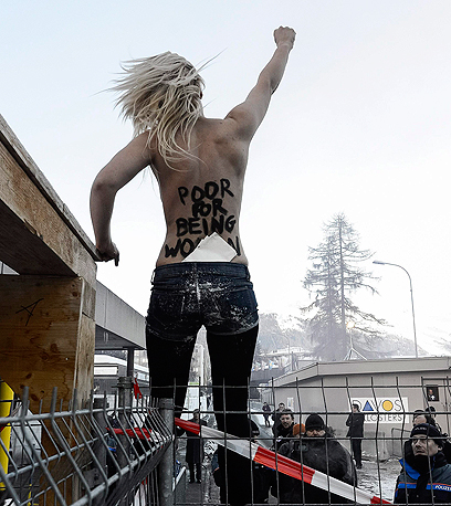 A protester at the Davos forum last year (Photo: AP/Archive)