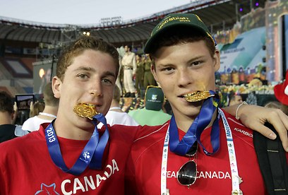 Canadian athletes sport their medals (Photo: Haim Zach)