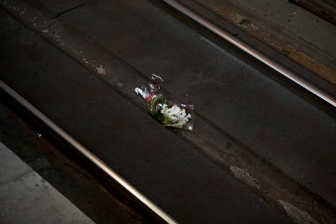 Mourners laid flowers at the attack sites. (Photo: AP) (Photo: AP)