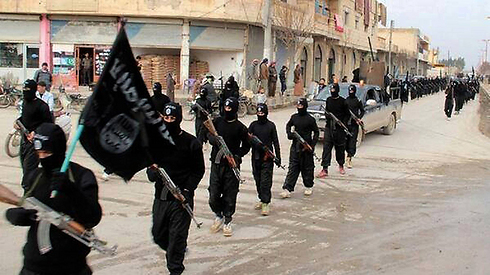 ISIS militants marching through conquered territory in Iraq. (Photo: AP) (Photo: AP)