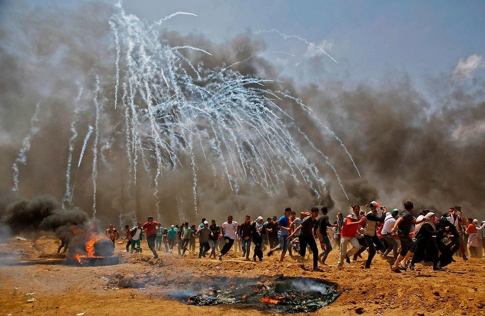 עזה Photo: העימותים בעזה נמשכים: הפלסטינים מדווחים על 28 הרוגים