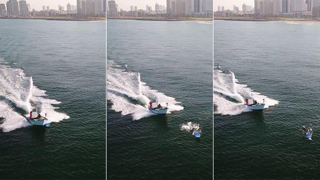 מצטיין תיעוד: גולש ניצל ברגע האחרון מפגיעת סירה ביפו WX-92