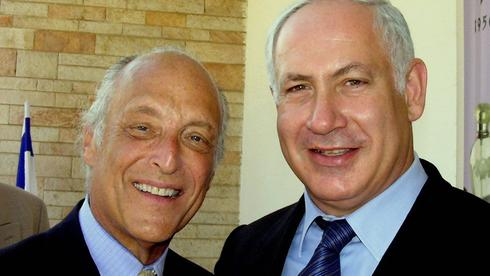 Benjamin Netanyahu, right, with his close friend Spencer Partridge in 2004  ()