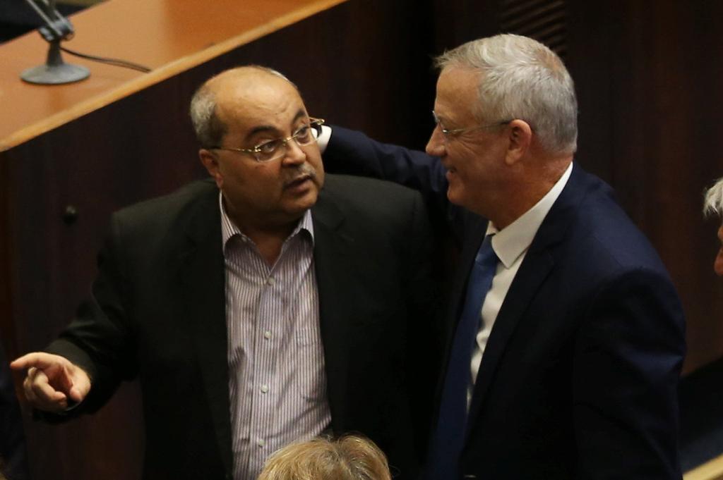 Gantz with Joint List leader Ahmad Tibi during Knesset plenum ()