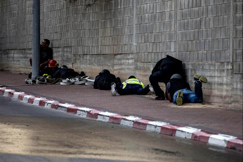 people seek cover during missile attack (Photo: AP)