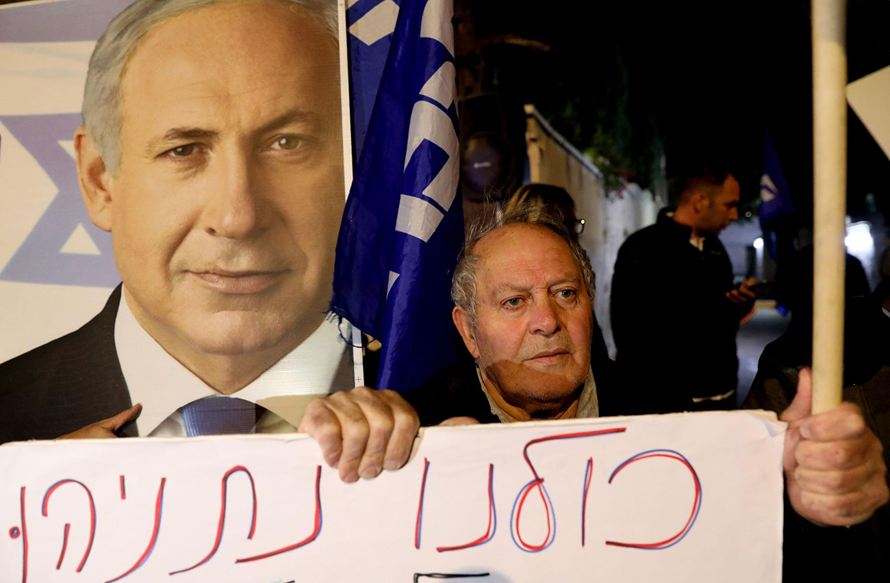 A protest in support of Benjamin Netanyahu after his indictment was announced  (Photo: AFP)