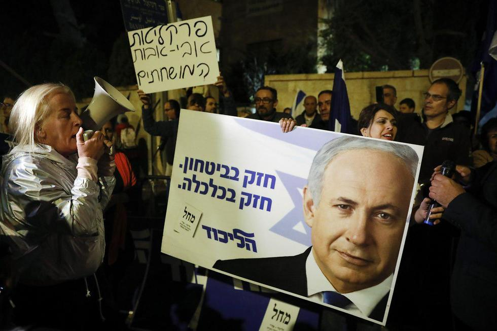 Supporters of Benjamin Netanyahu protest in Jerusalem after he was indicted Thursday  (Photo: AFP)