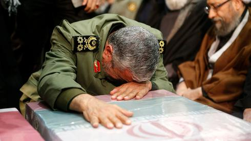 An Iranian official weeps at Qasem Soleimani's funeral procession in Tehran  (Photo: AFP)