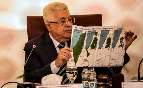 Palestinian President Mahmoud Abbas criticizing the Trump plan at an Arab League summit in Cairo in February  ()