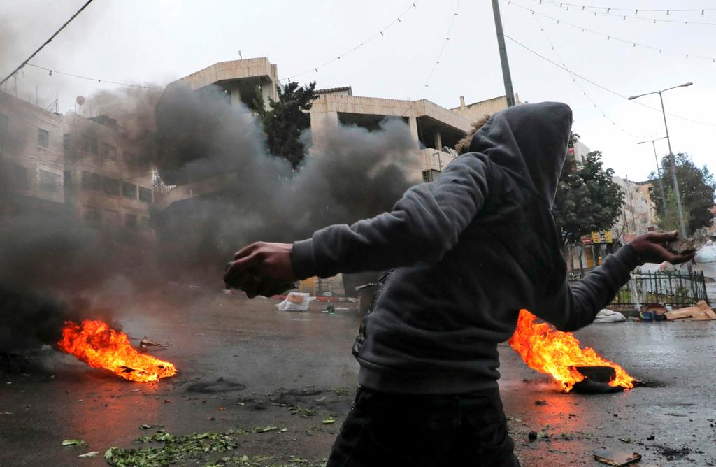 Palestinian rioter in the West Bank  ()