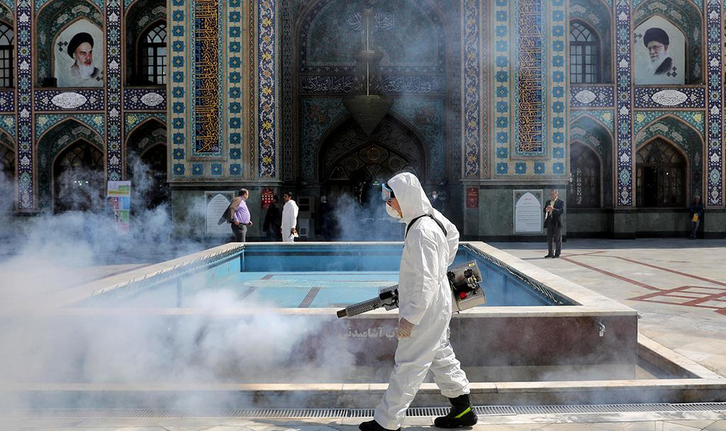 A medical worker in Iran disinfecting a Mosque in Tehran  ()