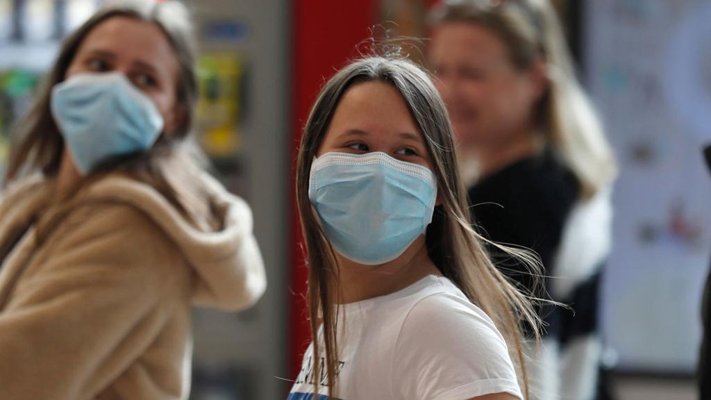 People with surgical masks at Ben Gurion Airport  ()