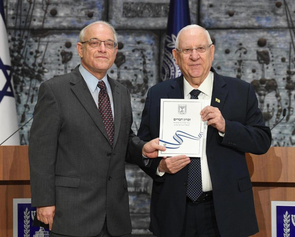 Central Elections Committee Chairman Neal Hendel (left) handing President Reuven Rivlin the official results of the election to the 23rd Knesset  ()