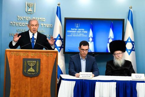 Prime Minister Benjamin Netanyahu, Health Ministry DG Moshe Bar-Siman-Tov and Health Minister Yaakov Litzman make televised statements during the coronavirus lockdown  ()