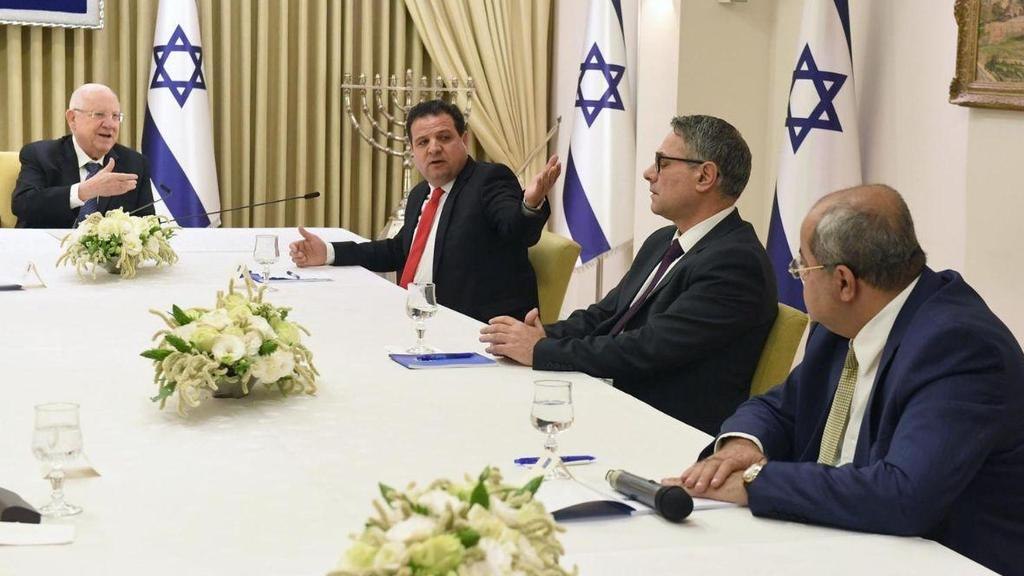 President Reuven Rivlin, left, meets with members of the Joint List, including Ayman Odeh, 2nd left  ()