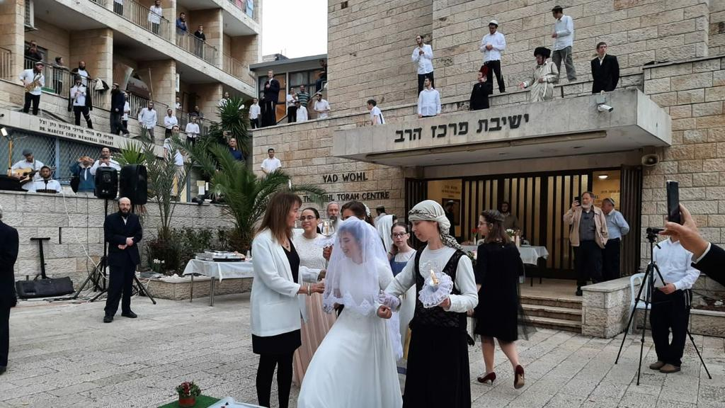An ultra-Orthodox wedding is held at a Jerusalem yeshiva, with celebrants observing the directives to  keep their distance ()
