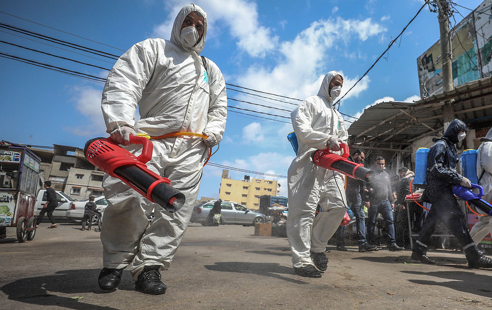 Health workers disinfect the streets in the Gaza Strip  ()