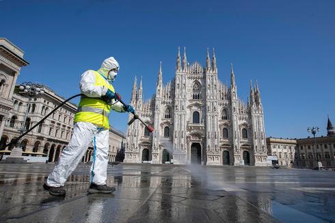 Disinfecting the street of Milan  (Photo: AP)