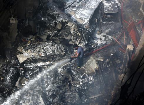זירת ההתרסקות בחודש שעבר (צילום: AP) (צילום: AP)