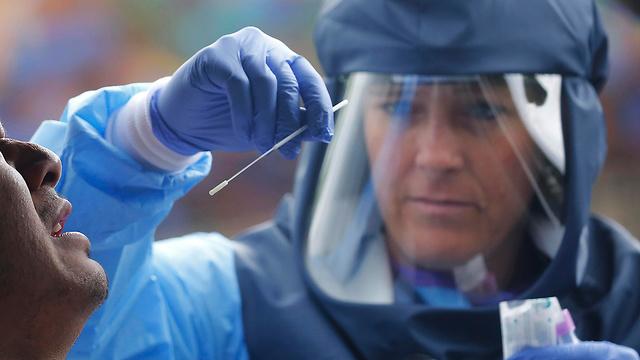 Анализ на коронавирус. Фото: AP  ()