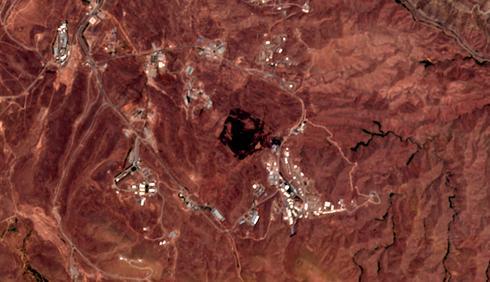 האזור החרוך אחרי הפיצוץ בשבוע שעבר, כפי שנצפה מהלוויין (צילום: AP)