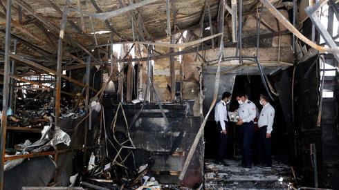 Место взрыва в поликлинике Тегерана. Фото: EPA ()